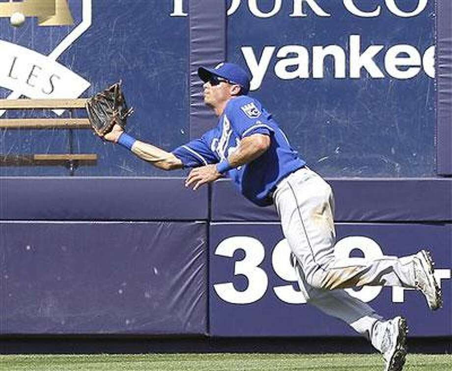Kansas City Royals center fielder Rick Ankiel makes a diving catch on a ball hit by New York Yankees' Nick Swisher in the eighth inning of a Major League Baseball game Saturday, July 24, 2010 at Yankee Stadium in New York. The Royals won 7-4. (AP Photo/Julie Jacobson)