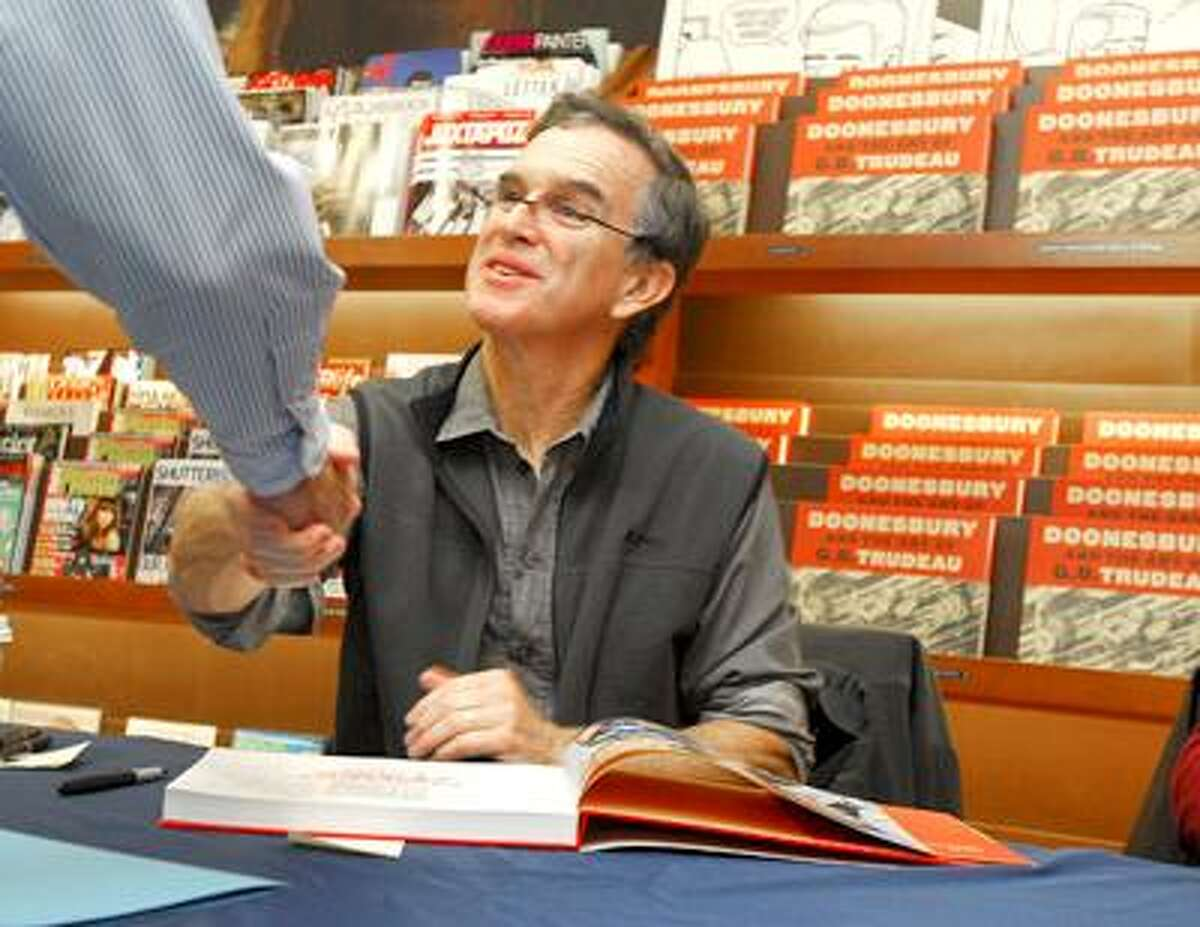 """Doonesbury creator Gary Trudeau greets a fan at Yale Bookstore Barnes and Noble's book signing of """"Doonesbury and the Art of G.B. Trudeau"""" Wednesday afternoon prior to his lecture that evening. Photo by Brad Horrigan/New Haven Register. 11.03.10. 101103-BH0705."""