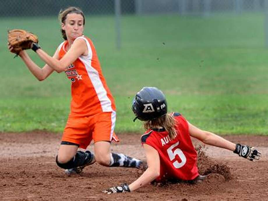 Fairfield's Patricia Auray slides safely into second with a stolen base ahead of the tag from Orange shortstop Jill DeMaio. Orange beat Fairfield 2-0 in the Section I title game Friday night in Danbury.