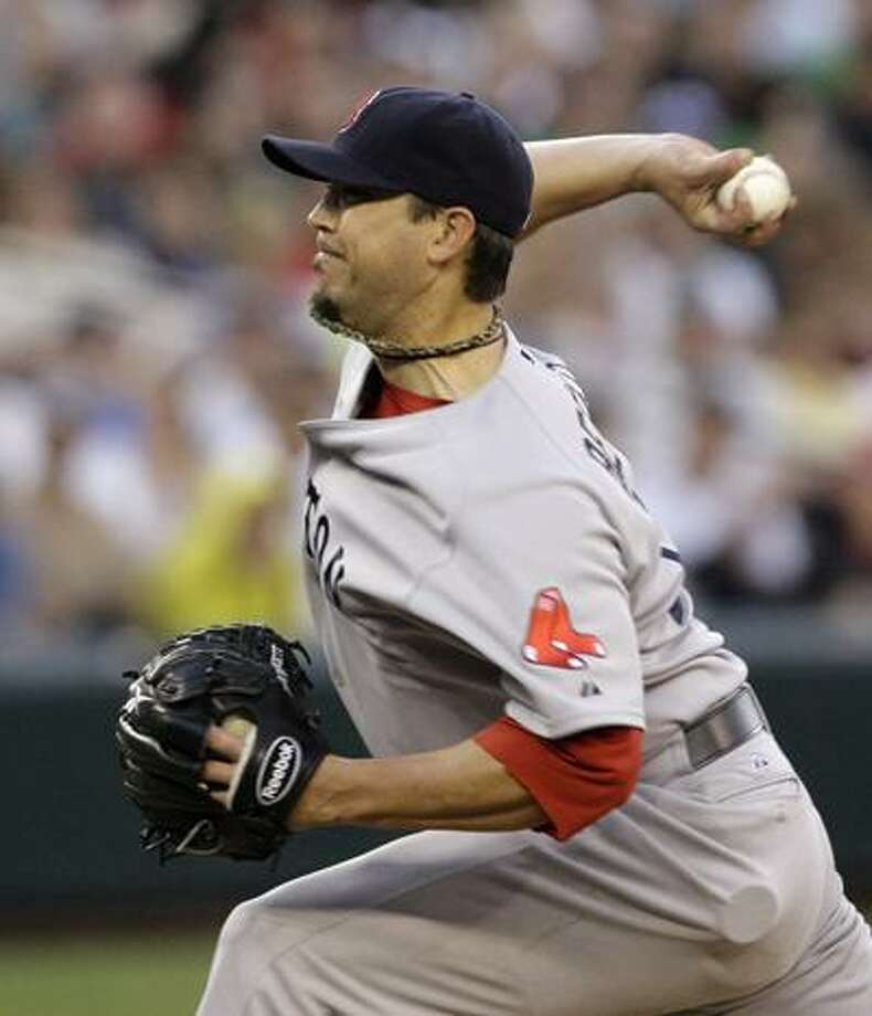Red Sox pitcher Josh Beckett returned from the DL to help lead Boston to a 2-1 victory over the Mariners Friday night in Seattle. (Associated Press/Elaine Thompson) Photo: AP / AP