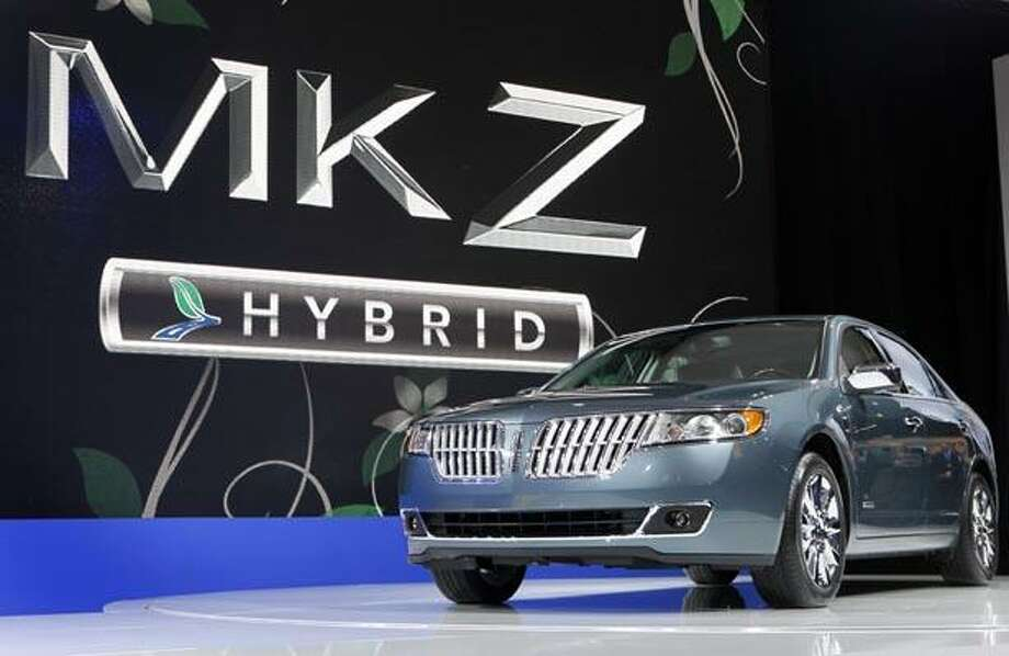 In this photo made March 31, 2010, released by Microsoft Corp., a new Lincoln MKZ Hybrid is unveiled at the New York International Auto Show in New York. Ford Motor Co. will soon have a first in the U.S. auto market: a hybrid sedan that costs the same as the gas-powered version. (AP Photo/Microsoft Corp., David Goldman) Photo: AP / AP2010