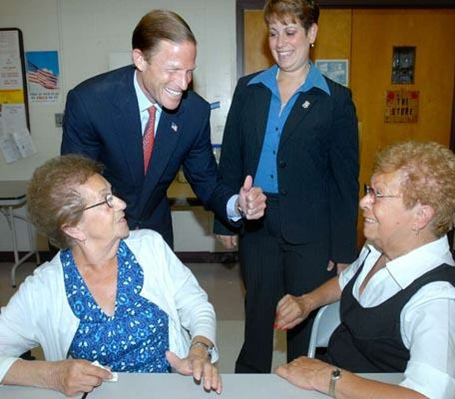 Attorney General Richard Blumenthal (top left) and East Haven Mayor Mayor April Capone Almon (top right) talk with Bridget Mathews (bottom left) and Sarah Cerilli (bottom right) of East Haven at the East Haven Community Center. (Arnold Gold/Register)