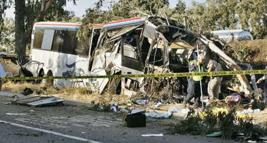 California Highway Patrol officers investigate a Greyhound bus crash on Highway 99 in Fresno, Calif., that killed at least six people and injured many others Thursday, July 22, 2010. (AP Photo/Gary Kazanjian) Photo: AP / FR71556 AP