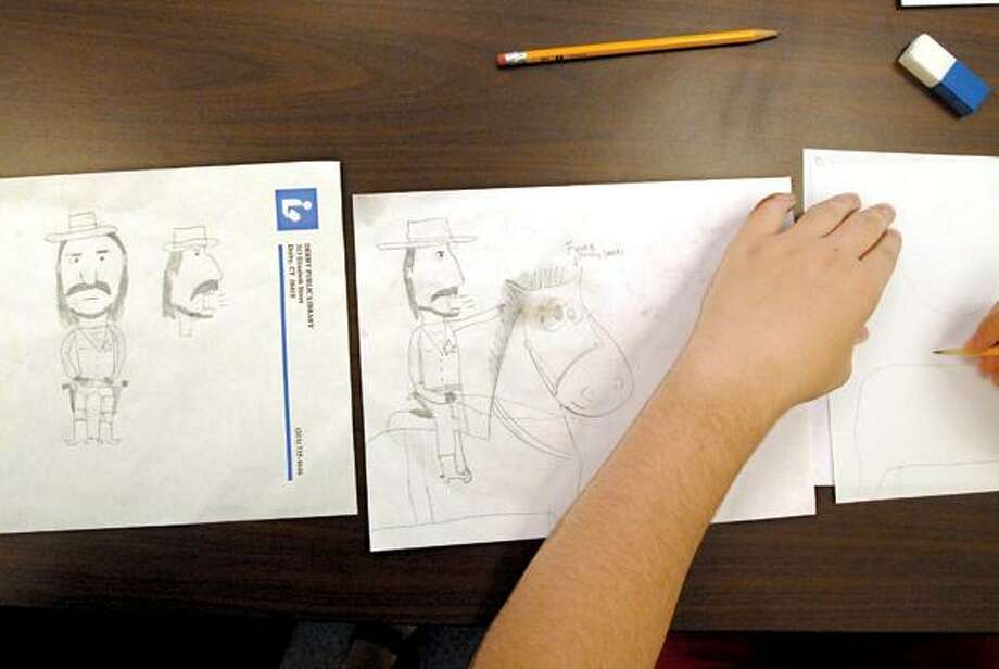 John Pertoso of Ansonia works on his western characters during class.
