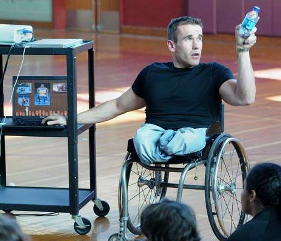 North Haven--Connecticut-native Ryan Martin, a professional wheelchair basketball player in Spain, speaks to students at North Haven Middle School. Photo by Brad Horrigan/New Haven Register-12/22/10.