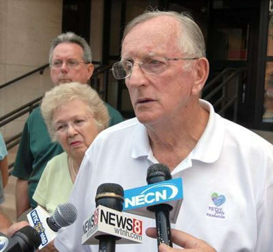 William Petit Sr. right speaks with reporters outside New Haven Superior Court. With him is his wife, Barbara, center, and brother-in-law Larry Joyce, left. Photo by Mara Lavitt