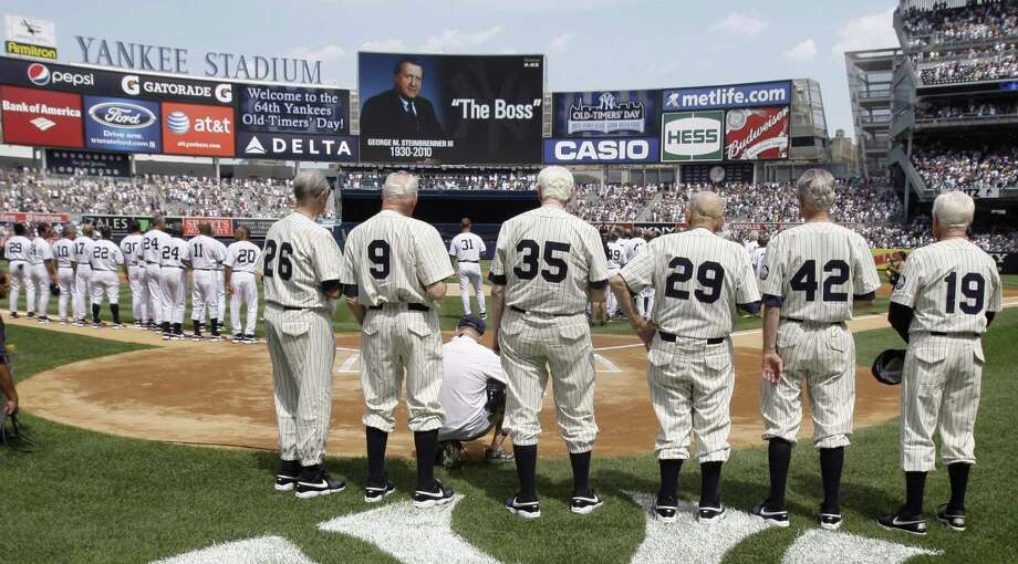 Retired New York Yankees players, left to right, Don Johnson, Hank Workman, Duane Pillette, Charlie Silvera, Jerry Coleman, and Whitey Ford, pause to remember team owner George Steinbrenner during Old-Timers' Day ceremonies at Yankee Stadium on Saturday, July 17, 2010 in New York. Steinbrenner died on Tuesday. (AP Photo/Frank Franklin) Photo: ASSOCIATED PRESS / AP