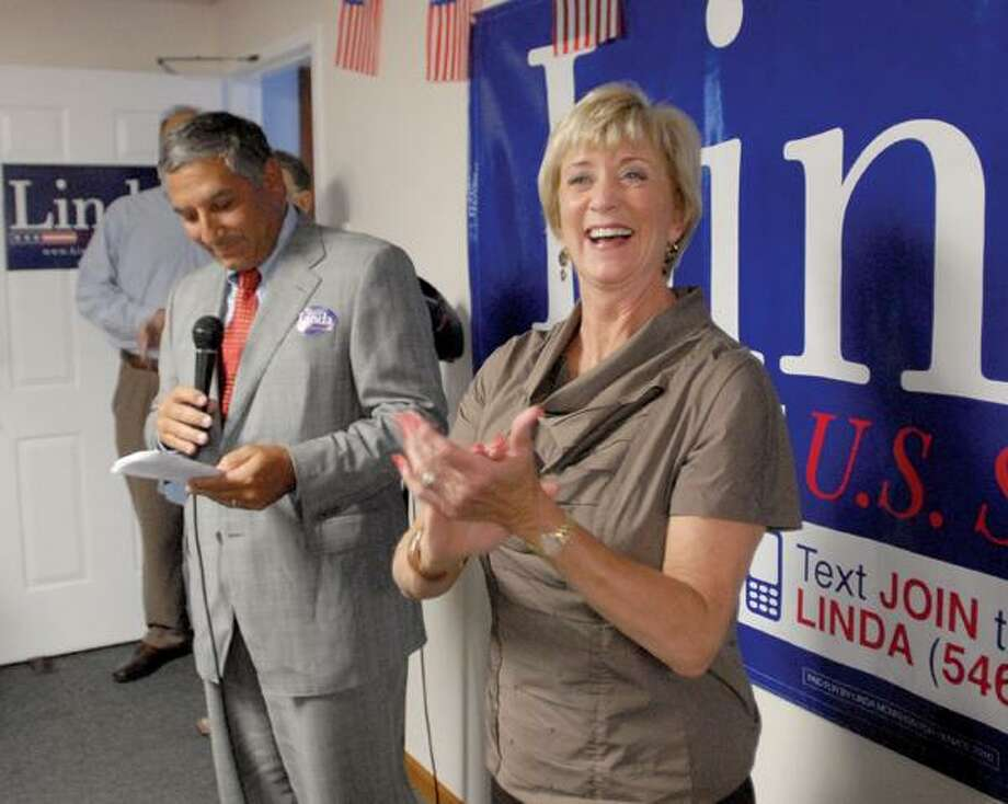 Linda McMahon stands with state Sen. Lenoard A. Fasano, R-East Haven, during last week's opening of her East Haven campaign office. (Peter Hvizdak/Register)