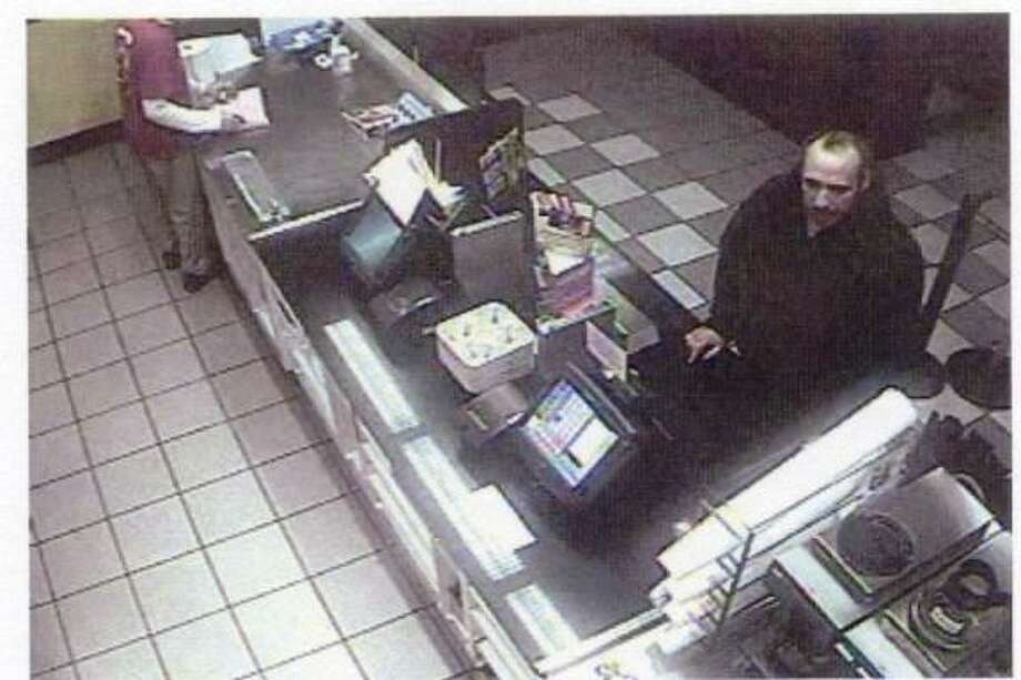 This photo releaased by New Haven police shows a man suspected in a robbery at Dunkin' Donuts on Foxon Boulevard in New Haven