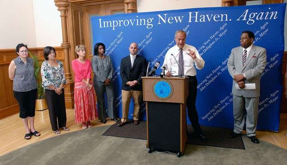 Mayor John DeStefano Jr. talks about the Connecticut Mastery Test results Thursday. He is flanked by Superintendent of Schools Reginald Mayo, right, and, from left, John C. Daniels School Principal Gina Wells, Katherine Brennan/Clarence Rogers School Principal Karen Lott, and Barnard Environmental Studies Magnate School Principal Mike Crocco. Peter Casolino/Register