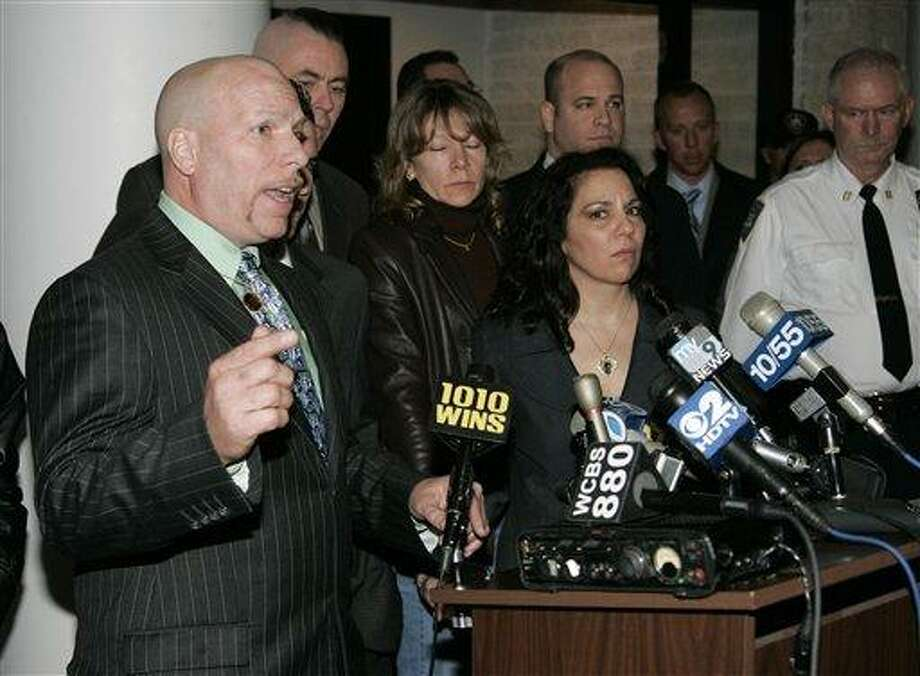In this March 19, 2008 file photo, Daniel Cicciaro, Sr., left, speaks to reporters as Joanne Cicciaro, center and others look on in Riverhead, N.Y., after sentencing for John White, who was convicted of second-degree manslaughter and a weapon charge in connection with the shooting death of their son Daniel Cicciaro Jr. White was sentenced to two to four years in prison. New York Gov. David Paterson commuted the sentence Thursday, Dec. 23, 2010, of White, a decision in the final days of his administration that infuriated the lawyer who prosecuted the case. (AP Photo/Ed Betz, File) Photo: AP / AP2008