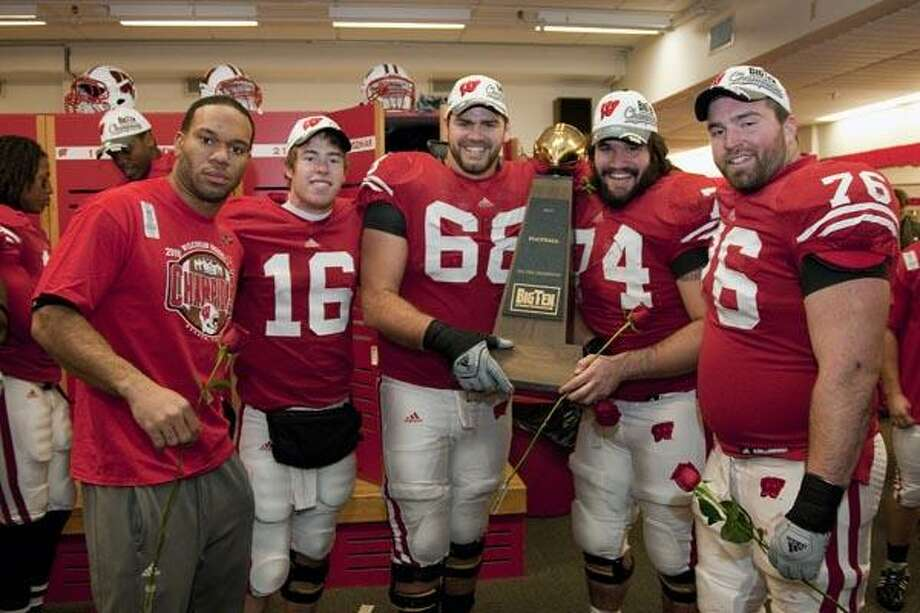 Wisconsin Badgers teammates Lance Kendricks (from left to right), Scott Tolzien (16), Gabe Carimi (68), John Moffit (74) and Bill Nagy (76) pose with the Big Ten Conference Trophy after an NCAA college football game against the Northwestern Wildcats on November 27, 2010 in Madison, Wisconsin. The Badgers won 70-23. (Photo by David Stluka) Photo: David Stluka / 2010 David Stluka