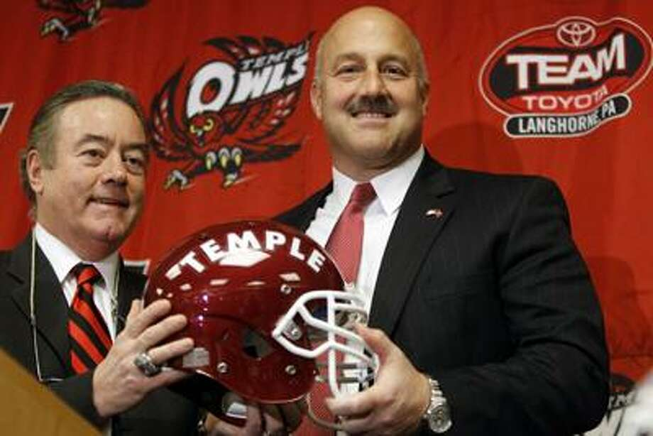 Steve Addazio, right, poses for photographs with athletic director Bill Bradshaw during an NCAA college football news conference at Temple University in Philadelphia, Thursday, Dec. 23, 2010. Temple hired Florida offensive coordinator Addazio to replace Al Golden as its football coach. (AP Photo/Matt Rourke) Photo: AP / AP