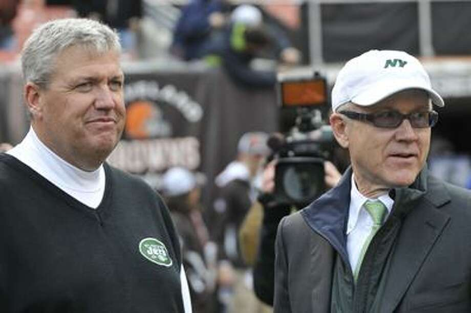 "FILE - In this Nov. 14, 2010, file photo, New York Jets head coach Rex Ryan, left, and owner Woody Johnson look on during warmups before an NFL football game against the Cleveland Browns in Cleveland. Johnson says his respect for Ryan hasn't diminished ""one iota,"" a day after the embarrassed coach declined comment about a foot-fetish report posted by the sports website Deadspin. (AP Photo/David Richard, File) Photo: AP / AP2010"