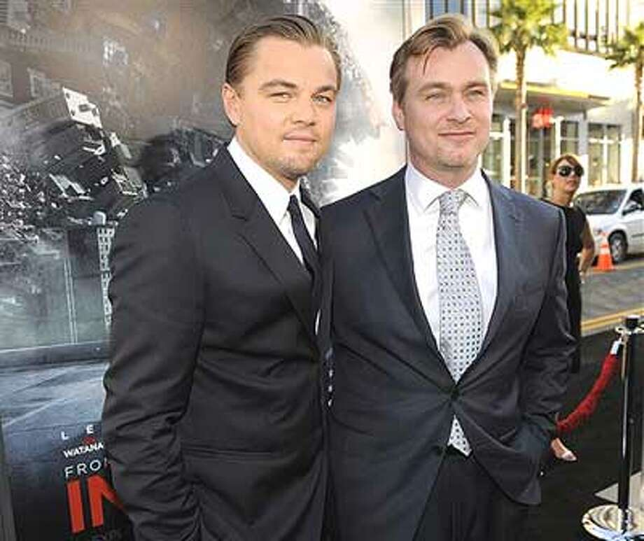 "Leonardo DiCaprio, left, star of the film ""Inception,"" poses with the film's director Christopher Nolan at the premiere of the film in Los Angeles, Tuesday, July 13, 2010. (AP Photo/Chris Pizzello)"
