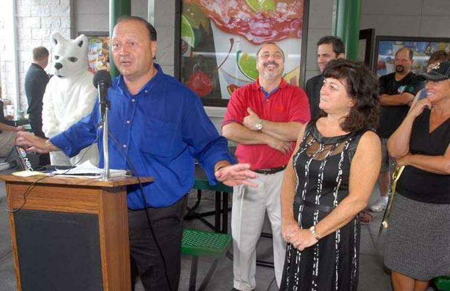 RIGHT: Franchise owners and siblings, from left, Robert Mesite, Ralph Mesite and Gina Mesite Mueller speak at the opening. The Mesite Family Limited Partnership of Meriden is the chain's Connecticut franchisee, and plans to open additional Sonic locations in the state.  (Mara Lavitt)