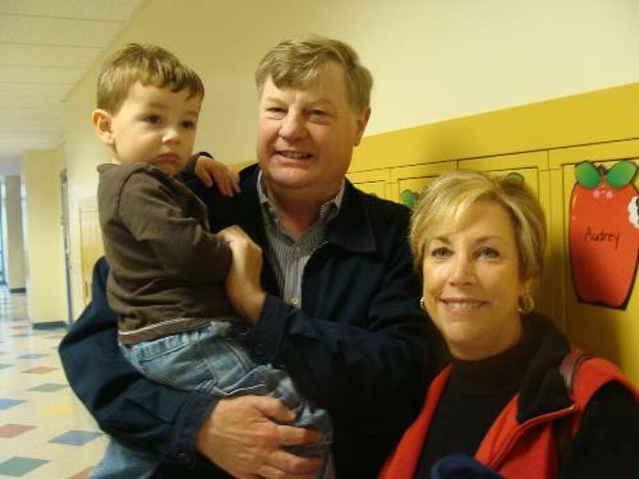 Former Wallingford Superintendent of Schools Dale Wilson and his wife Sharon are shown in an undated photo with their grandson Christopher, who is now 3. Sharon Wilson is in critical condition in Yale-New Haven Hospital from injuries she suffered in a two-car accident Saturday night. Dale Wilson also is hospitalized with a two broken bones in his neck, a broken hip and a shattered bone in his arm.