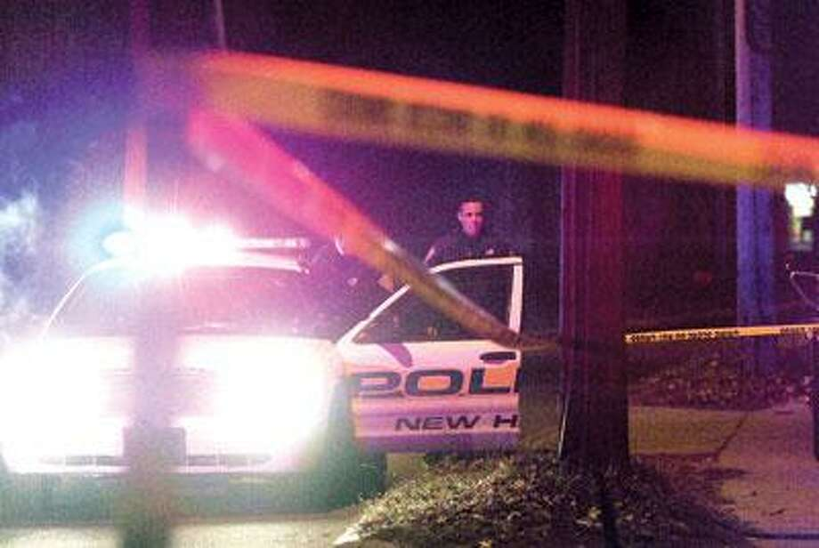 Police investigate a homicide at 321 Forbes Avenue on Sunday night. (Brad Horrigan/New Haven Register)