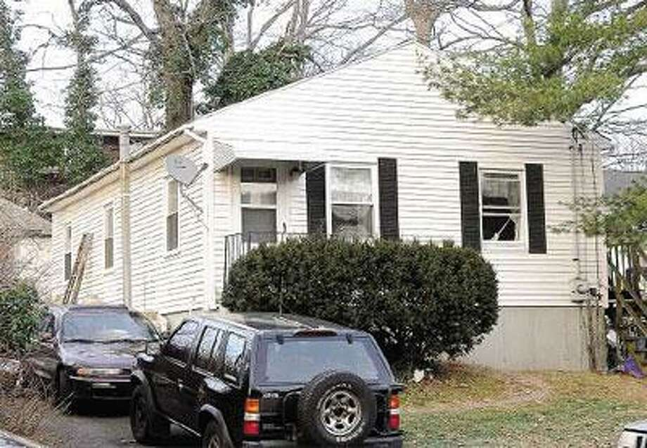 Nine people were rescued from a house at 534 Smith Ave. early Saturday. (Brad Horrigan/Register)