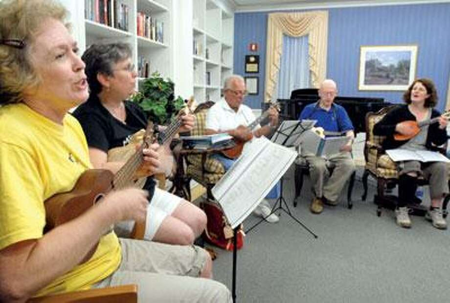 The Kookieukies meeting to practice at Laurel Estates in Milford, seated left to right: Christine O'Sullivan of Westport, Lisa Brelsford of Orange, Lisa's father George Lewis of Orange, Frank Broderick of Orange and Denise Willoughby of Milford. (Mara Lavitt/Register)