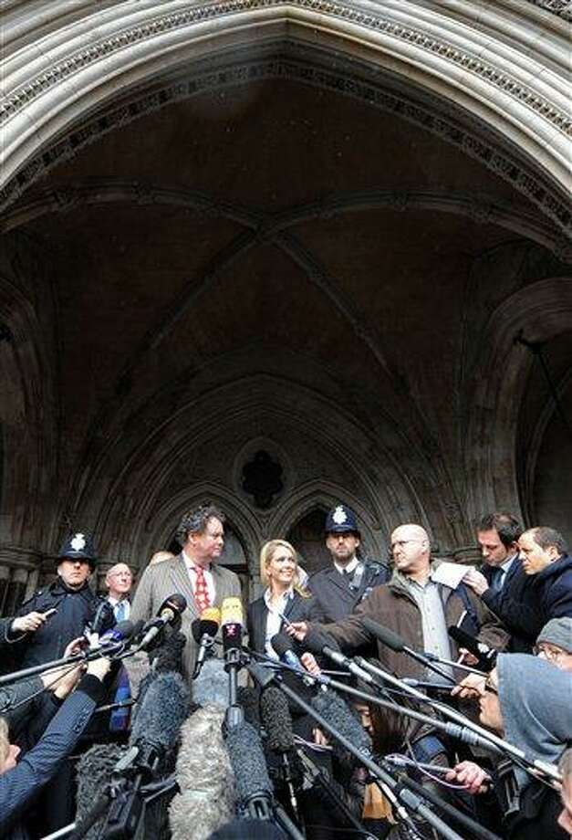 Mark Stephens, lawyer for WikiLeaks founder Julian Assange, centre left, delivers a statement to the media outside the High Court, London, Thursday, Dec. 16, 2010. Julian Assange will be freed on bail and sent to stay at a British country mansion, a judge ruled Thursday, rejecting prosecutors' attempts to keep the WikiLeaks founder in prison as he fights extradition to Sweden. (AP Photo/Adrian Dennis, pool) Photo: AP / Pool, AFP