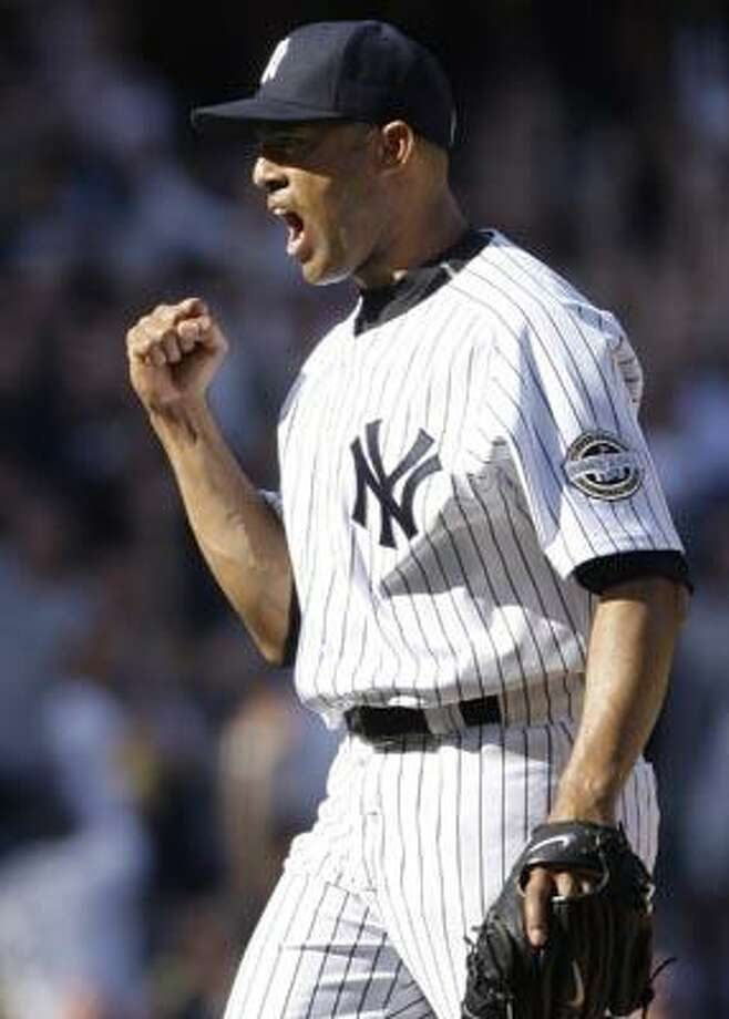 FILE - In this April 17, 2009, file phot,  New York Yankees pitcher Mariano Rivera reacts after striking out Cleveland Indians' Mark DeRosa to end the game in a Major League Baseball game in New York.  Rivera and the Yankees have finalized their $30 million, two-year contract on Tuesday, Dec. 14, 2010. The 41-year-old closer receives $15 million in each of the next two seasons, with $1.5 million each year deferred with no interest. The deferred money will be paid in $1 million annual installments starting in 2013. (AP Photo/Julie Jacobson, File) Photo: AP / AP2009