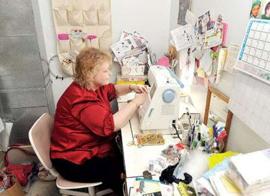 Fiore does a great deal of sewing right in her shop. (Peter Casolino/Register photos)