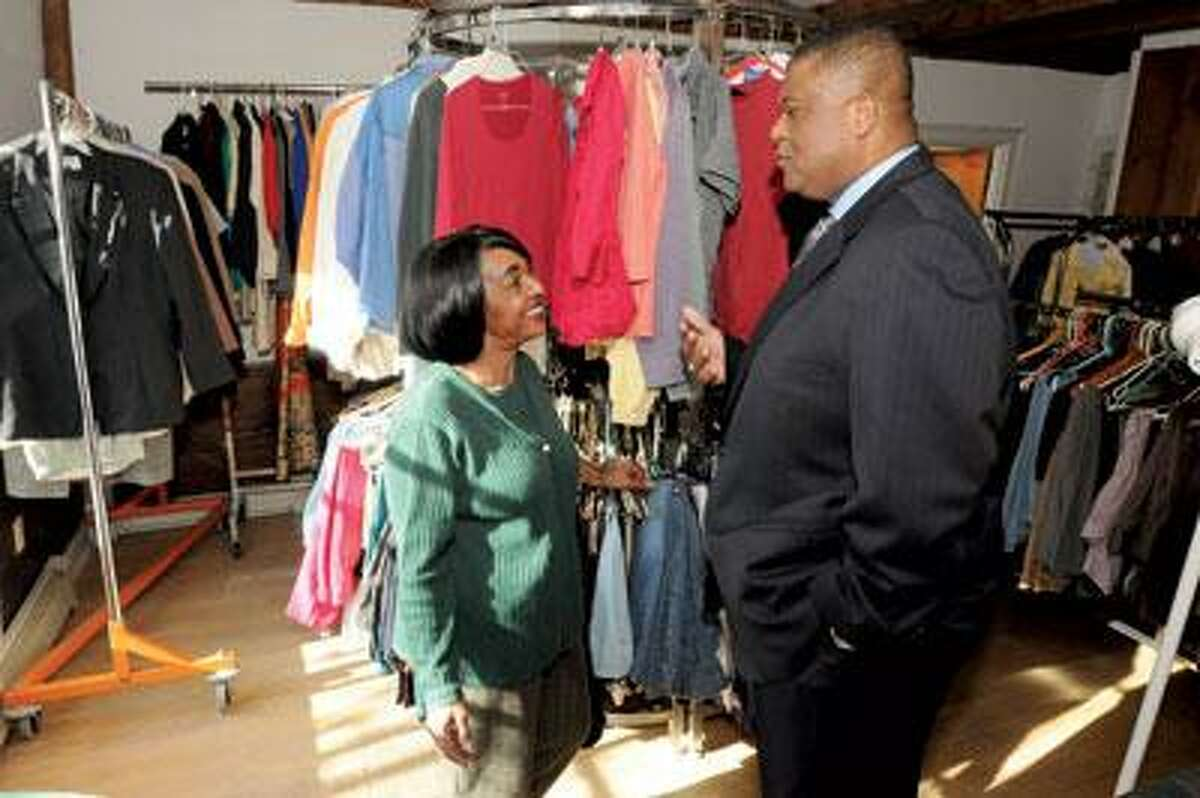 The Clothes Closet, operated by the First Baptist Church in Milford runs on donated items and patrons shop for free. It is the brain child of Laura Williams of Milford, left, shown here with Pastor Calvin Robinson. (Mara Lavitt/Register)