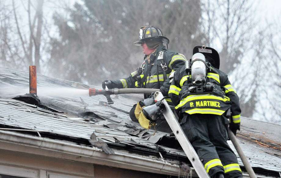 New Haven-- New Haven firefighters battle a 2 alarm blaze at the housing complex at 1314 Quinnipiac Avenue in the late afternoon Monday. Photo by Peter Casolino/New Haven Register 12/13/10 Cas101213