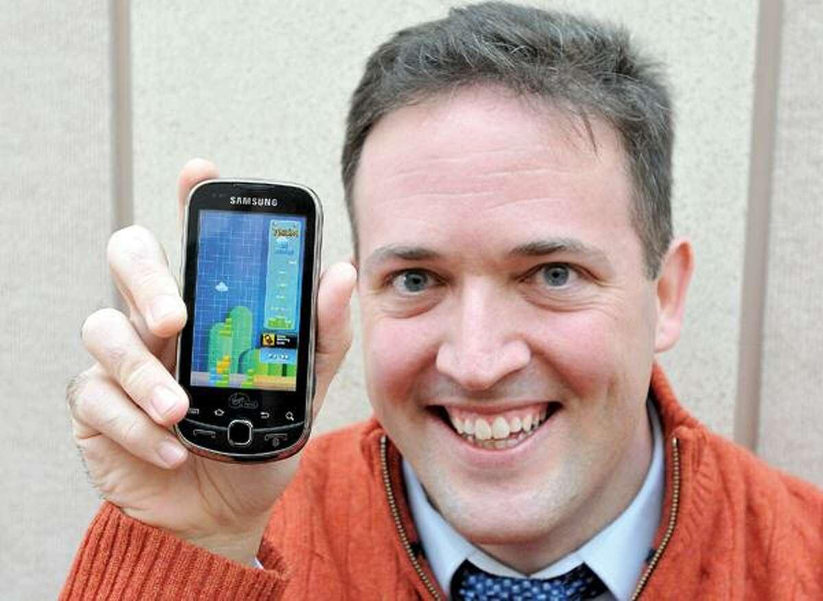 Peter Casolino/Register photo, Guilford resident Lou Rinaldi, 33, has been a Tetris fan since sixth grade.