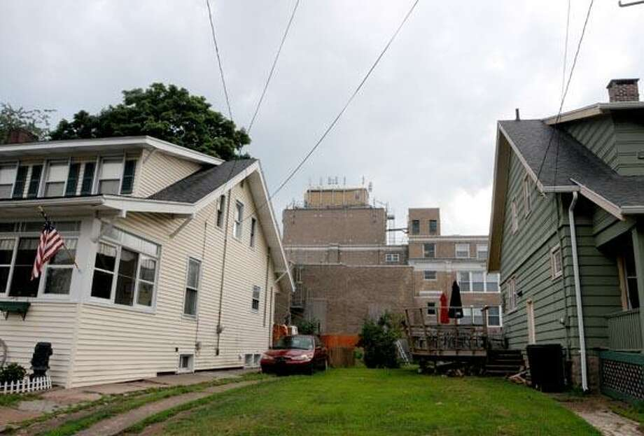 Photography by PETER HVIZDAK   ph2133   #4273West Haven Connecticut- July 29, 2010:  Cellular phone towers on the  top of the Giannotti Apartments at 278 Main Street, rear of photo, as seen from the Martin Street neighborhood.
