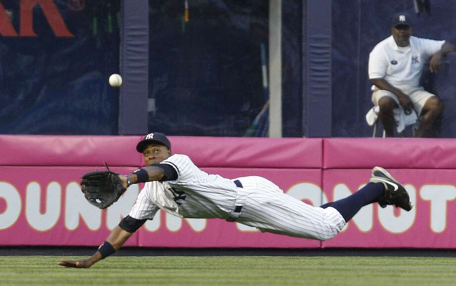 Yankees center fielder Curtis Granderson makes a diving catch on the Tigers' Johnny Damon's first-inning flyout. New York beat Detroit Tuesday night 6-2 at Yankee Stadium. (Associated Press) Photo: ASSOCIATED PRESS / AP