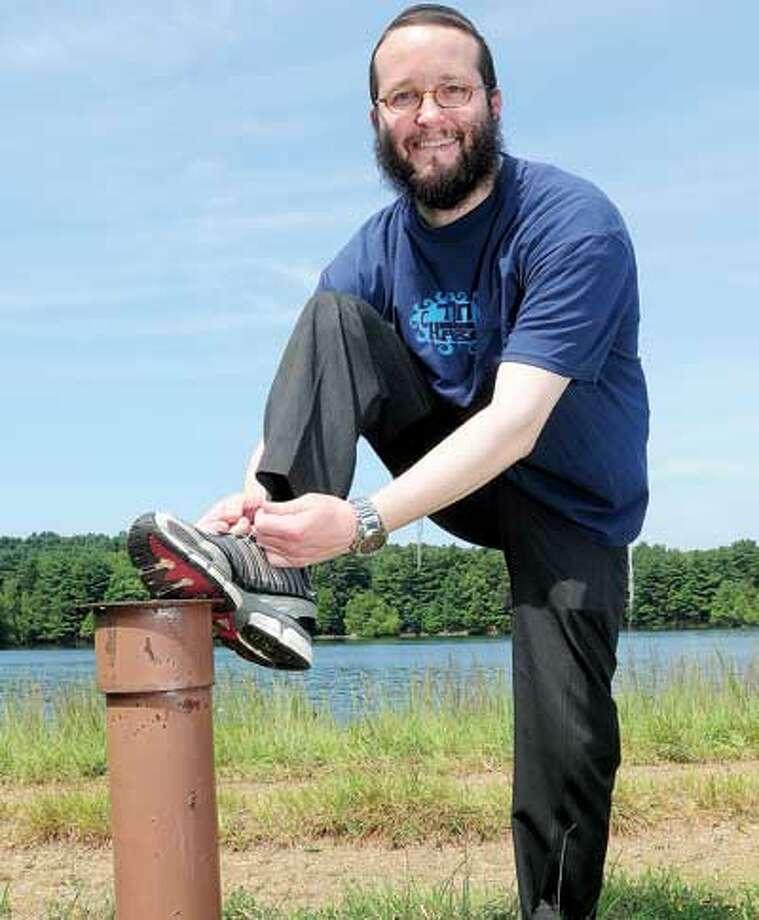Rabbi Adam Haston is training to run the New York City marathon to raise money for needy Jewish survivors of Nazi persecution. (Brad Horrigan/Register)