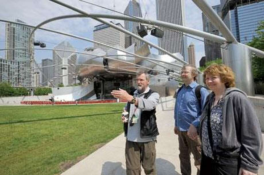 Chicago Greeter Milan Stevanovich, left, gives a tour of Frank Gehry's Jay Pritzker Pavilion, in Millennium Park. (AP Photo)