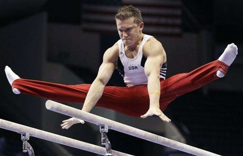 Jonathan Horton performs on the parallel bars during his first rotation during the men's senior division at the U.S. Gymnastics Championships in Hartford, Conn., Friday, Aug. 13, 2010.(AP Photo/Charles Krupa) Photo: AP / AP