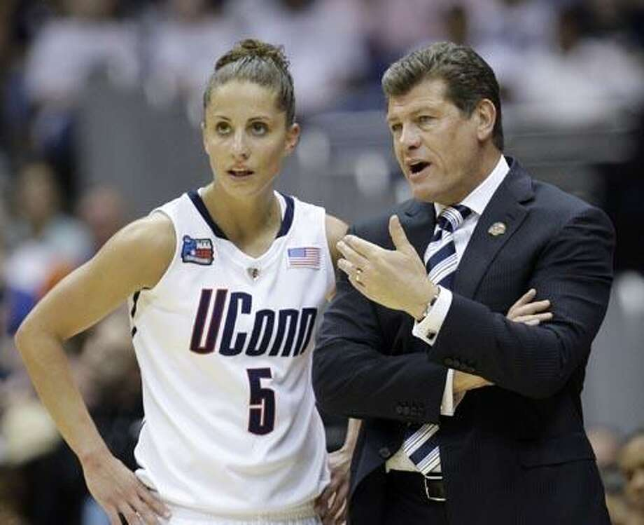 Connecticut coach Geno Auriemma talks to Caroline Doty (5) in the first half of the women's NCAA Final Four college basketball championship game against Stanford Tuesday, April 6, 2010, in San Antonio. (AP Photo/Eric Gay) Photo: AP / AP