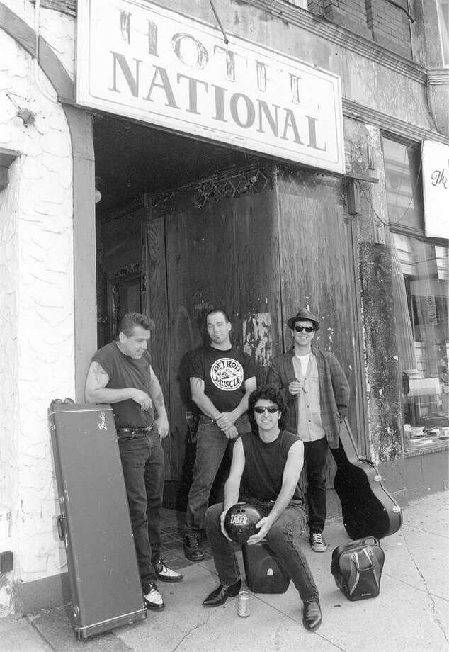 """The Big Bad Johns, in front of New Haven's former Hotel National on Crown Street back a dozen or so years ago, include bassist Paul """"Nervus Chet Purvis"""" Mayer, left, vocalist Richard """"Detroit Dick"""" Hulett, drummer """"Jumpin' Jim"""" Balga and guitarist Gary """"Buzz Gordo"""" Mezzi. Missing from this photo is later addition """"Country Bill"""" Collins. Contributed photo"""