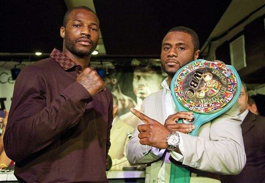Challenger Chad Dawson, left, and WBC-IBO light heavyweight champion Jean Pascal,  pose during a news conference Wednesday, Aug. 11, 2010,  in Montreal. The title fight will be Saturday night in Montreal. (AP Photo/The Canadian Press, Paul Chiasson) Photo: AP / CP