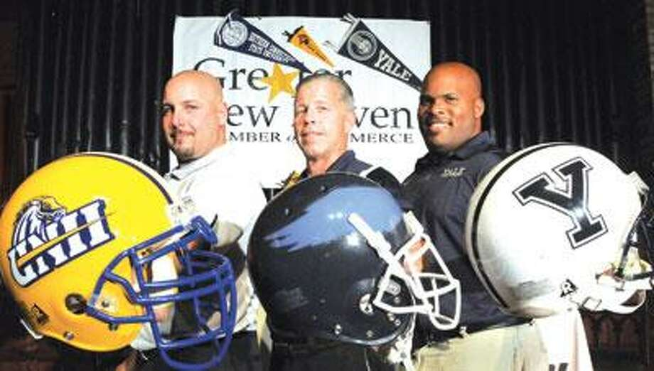 """The """"Chalk Talk"""" lineup of area college football coaches during a Greater New Haven Chamber of Commerce Sports Council gathering on Wednesday featured (left to right) Pete Rossomando of the University of New Haven, Rich Cavanaugh of Southern Connecticut State, and Tom Williams of Yale University. (Peter Hvizdak/Register)"""