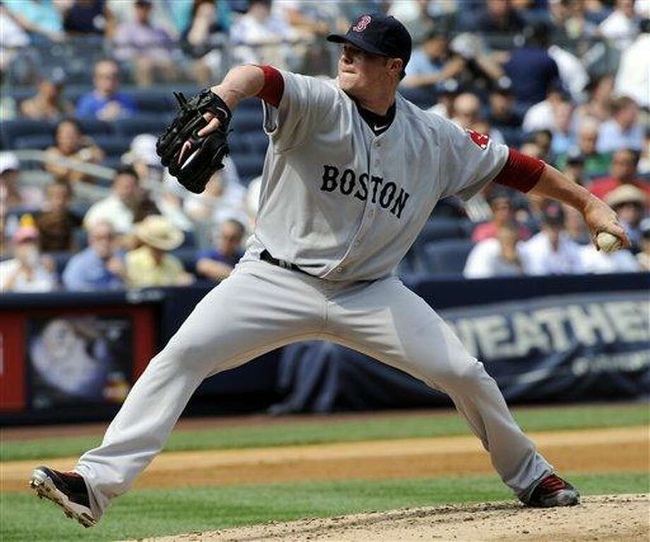 Boston Red Sox pitcher Jon Lester delivers the ball to the New York Yankees during the second inning of a baseball game Monday, Aug. 9, 2010,  at Yankee Stadium in New York. (AP Photo/Bill Kostroun) Photo: AP / FR51951 AP