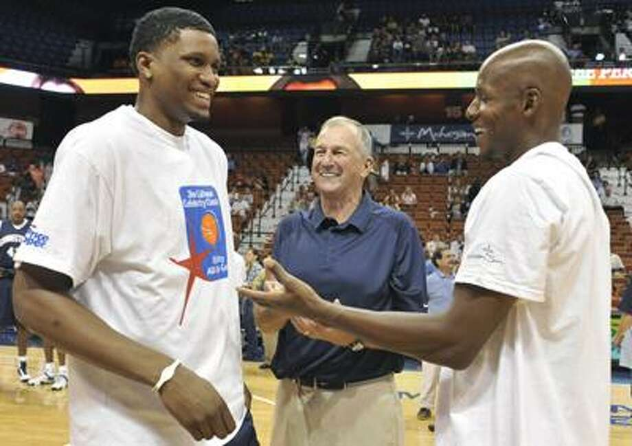 Former UConn players Rudy Gay, left, and Ray Allen talk with their former coach Jim Calhoun prior to the Jim Calhoun Celebrity Classic Charity All-Star basketball game Saturday in Uncasville. (Associated Press/Jessica Hill) Photo: AP / AP2010
