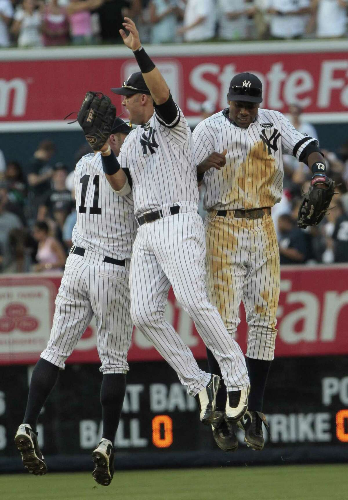 Nick Swisher, center, celebrates with Brett Gardner, left, and Curtis Granderson, right, after their 5-2 win over the Boston Red Sox Saturday in New York. (Associated Press/Frank Franklin II)
