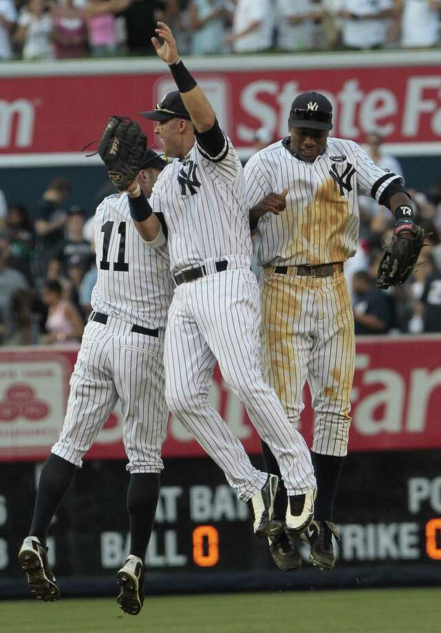 Nick Swisher, center, celebrates with Brett Gardner, left, and Curtis Granderson, right, after their 5-2 win over the Boston Red Sox Saturday in New York. (Associated Press/Frank Franklin II) Photo: ASSOCIATED PRESS / AP