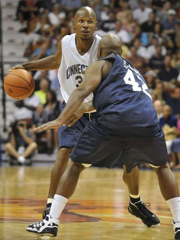 Ray Allen is guarded by Khalid El-Amin during the Jim Calhoun Celebrity Classic Charity All-Star basketball game Saturday in Uncasville. (Associated Press/Jessica Hill) Photo: AP / AP2010