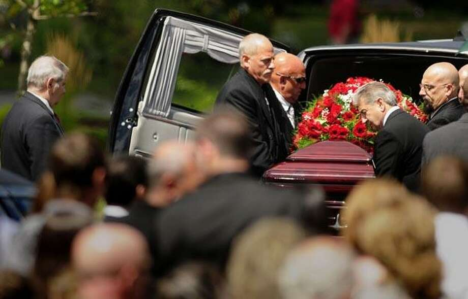 Pallbearers carry out the casket of Bryan Cirigliano, one of the nine people who died in the Hartford Distributors shooting, after arriving at West Meadow Cemetery in Newington, Conn. Saturday Aug. 7, 2010. (AP Photo/The Hartford Courant,  Bettina Hansen) Photo: AP / HARTFORD COURANT