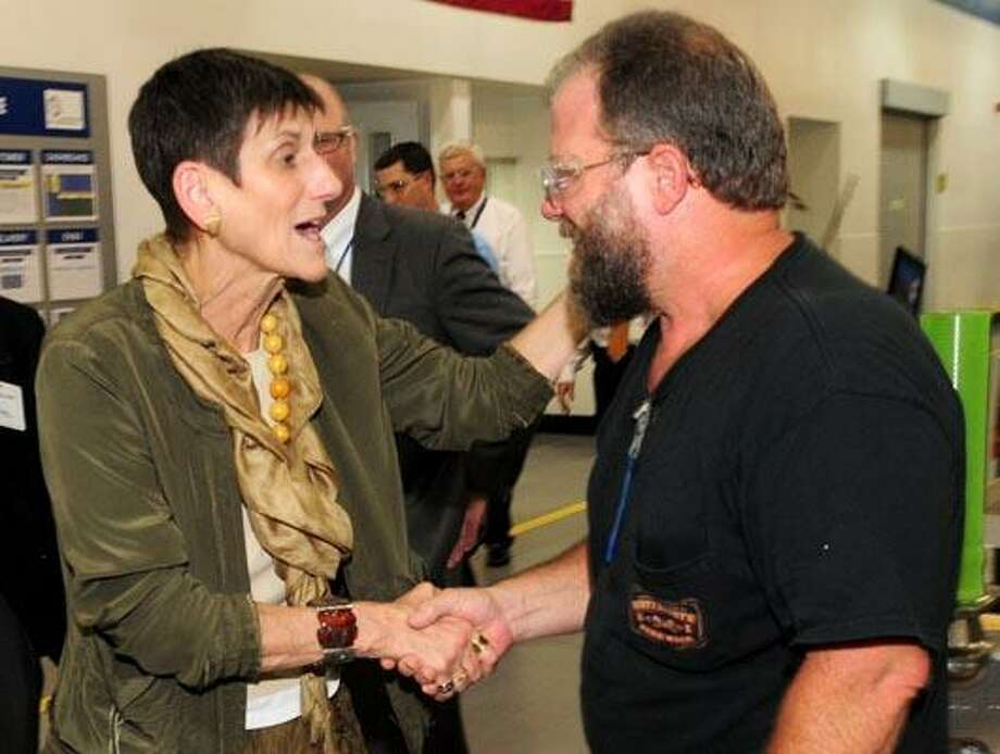U.S. Rep. Rosa L. DeLauro, D-3, greets Rich Brunner, a machinist from North Haven, on the production assembly line at Sikorsky Aircraft Corp. Thursday. (Brad Horrigan/Register)