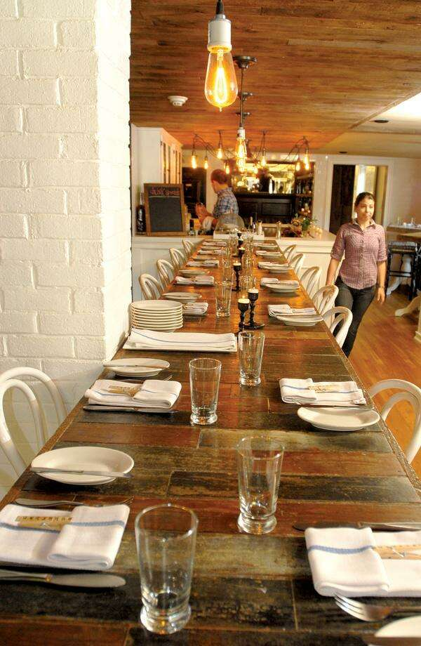 A view of a portion of the dining room. Photos by Peter Hvizdak/New Haven Register