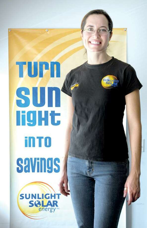 Arnold Gold/Register photo, Carolyn Humphreys is the outreach and marketing director for Sunlight Solar in Milford.