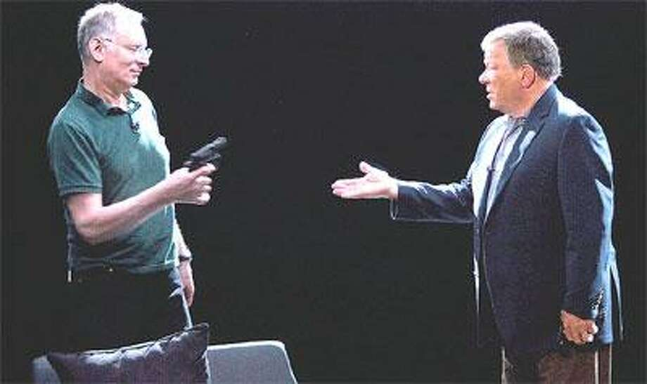"William Shatner queries Bernard Goetz, who shows him how he shot four men, on Bio's ""Aftermath."" (Bio Channel)"