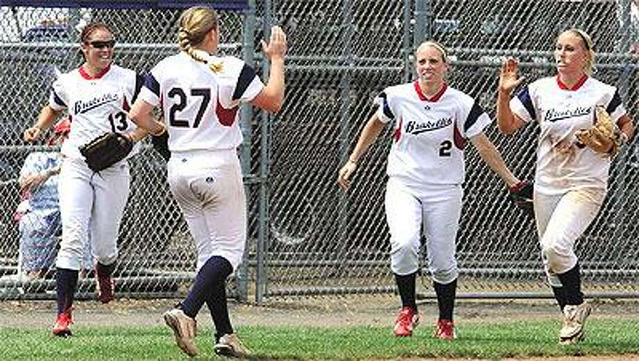 Stratford Brakettes pitcher Rachele Fico, second from left, celebrates with teammates Lindsey Bright, left, Mandie Fishback, second from right, and Jessica Mouse after beating the St. Louis Saints to win the Women's Major Softball National Championship on Sunday in West Haven. (Mara Lavitt/Register)